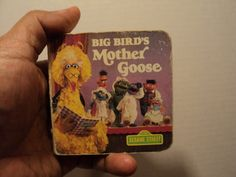 Big Bird's Mother Goose by Sesame Street. Featuring Jim Henson's Sesame Street Muppets. Photographs by John E. Barrett and View-Master International. In mini boardbook format. Used and in acceptable condition. Released in 1983. Clean. Without notes & highlighting in all its pages. Readable.