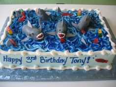 Sharks Sheet Cake by Beautiful Cakes, via Flickr - are those Twinkie sharks?!