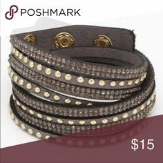 Wrap Around 🎀 bling stud bracelet Taupe color - adjustable.  Give your outfit trendy flare or just cover that tattoo you wish you never had! 💕🤗😜 1 inch wide laying flat (2 inches wide wrapped). 15.5 inches long laying flat. Button closure. Jewelry Bracelets