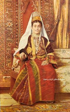 Middle East | Portrait of a woman wearing tradtional clothes an jewelry, Palestine