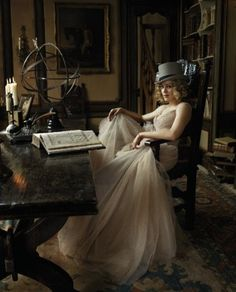 beautiful hat, beautiful dress, and a shelve full of books, what more could a girl ask for?