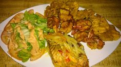 Grilled salmon,  fried breaded shrimps with fried plaintains and green salad