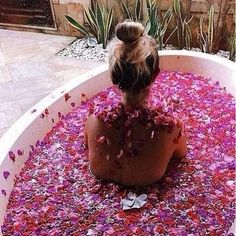 Having a bath with a million petals in it