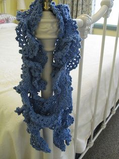 "The pattern is the Mermaid Scarf, available free online from Interweave Crochet (you need to sign up to their newsletter ""Knitting Daily"" to access the free patterns)."