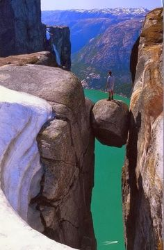 Kjeragbolten, Norway. Standing on this rock must be incredible! Would you dare??