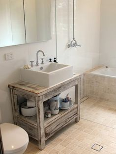 Desire Empire: Beach Home Decor: Nice how they converted old sea aged bench into a bathroom counter/sink