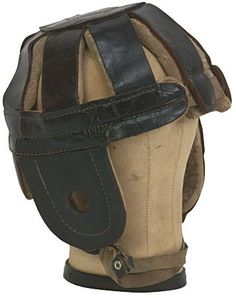 """Circa 1900 Spalding Black Leather Football Helmet. The """"Model J"""" helmet exhibits heavy cotton padding, original chin strap, and minimal use. There is a tear in one of the leather chin strap holders, otherwise the helmet displays only very light wear and is in Excellent condition overall.  Sold: $1,648"""