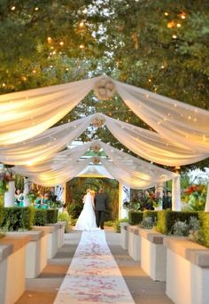 Grand drapery, twinkle lights, rose petals and an outdoor venue; the perfect recipe to the most romantic setting! #weddngs #romance