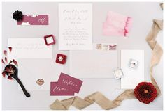 Wedding invitation and paper goods suite with berry accents, gold wax seal and calligraphy by Plume Calligraphy & Design. Ring by Trumpet & Horn, red velvet ring box by The Mrs. Box, ribbon by Froufrou Chic. Styling by Lauren Emerson Events & Design. Image by Melanie Gabrielle.