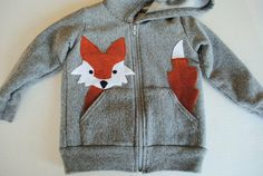 DIY fox in the pocket hoodie.  Precious.  The link is in Swedish, but I love this idea.  Seems pretty straightforward.
