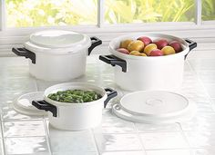 Microwave Cooking Pots: Prepare a plentiful meal in mere minutes! Generously sized containers are made to handle a variety of microwave cooking chores; snap-on lids keep leftovers nice and fresh. liter: 8 x 8 x 4 high liter: x x 3 high liter: x x high Cool Kitchen Gadgets, Kitchen Items, Cool Kitchens, Kitchen Dining, Cooking Bowl, Cooking Gadgets, Kitchen Essentials, Apartment Essentials, Kitchen Gadgets