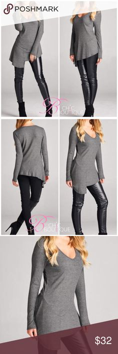 "❗️🚨SALE🚨❗️Gray Ribbed Long Sleeve Top Gray Ribbed Long Sleeve Top featuring a V neckline and asymmetrical hem. Made of Rayon/spandex blend. Also available in black in my closet. Marled. Measurements for small: laying flat from pit to pit 16""/ length 25"". MADE IN USA Bchic Tops"