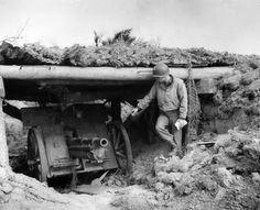 """A Infantry Division officer examines a German-manned French cannon overlooking Easy Red—typical of a variety of captured French weapons that the Germans pressed into service to defend the """"West Wall"""" D Day 1944, D Day Normandy, Normandy Ww2, Omaha Beach, German Men, Soviet Army, Lest We Forget, Back In Time, Military History"""