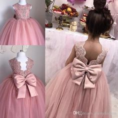 2018 cute flower girl dresses a line jewel cap sleeve floor length girls pageant dresses with lace applique bow for wedding party flower girl dresses for wedding flower girl ivory dresses from celine_weddingdress price dhgate com Bohemian Flower Girl Dress, Cute Flower Girl Dresses, Little Girl Dresses, Flower Girls, Sequin Flower Girl Dress, Mermaid Dresses, Girls Bridesmaid Dresses, Girls Dresses, Ivory Dresses