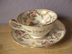antique gold tea cup and saucer set, Jackson and Gosling Grosvenor Ye Olde English, vintage 1920's pink rose hand painted. $99.00, via Etsy.