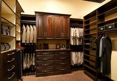 Custom, Stained Wood Walk In Closet By Classy Closets Features Double  Hanging Space,