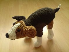 This dog requires a lot of sewing. I don't know how much yarn I used, one skein brown, merino, yarn held three strands together, the white and brown was polyacryl, two strands held together.