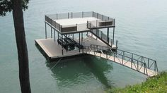 Tim's Ford was the site of completion to this beautiful CAT 5 dock earlier this week. DockScapes completed a beautiful upper level as well as added finishing touches to the body of the dock. The dock features TimberTech XLM SandRidge decking, and is structured to house a multi-slip with a wide side. The upper level features Aluminum Sandstone decking with antique bronze railing and beautiful stairs. A 45′ Arched Gangway with TimberTech XLM SandRidge decking.