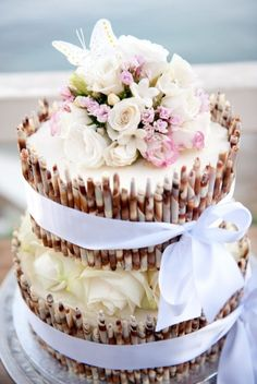 White & Milk Chocolate Cigarillo Wedding Cake with White Ribbons and Pale Pink & Ivory Florals