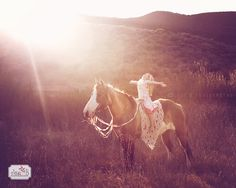 a little girl and her horse with incredible sunflare child photography session Image by Jesi B Photography www.jesibphtography.com