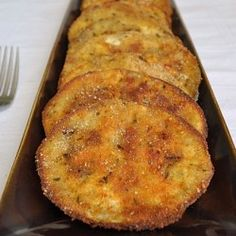 Baked Eggplant: Peel and slice eggplant into thumb-thick slices, salt on both sides and let sit 1hr. Wash slices(squeezing gently). Dip slices in egg and panko(w/ salt & pepper). Bake at 400F until soft on inside & crispy(browned) on outside(1hr). Sprinkle slices with fresh grated parmeson. Bake further until cheese melts.
