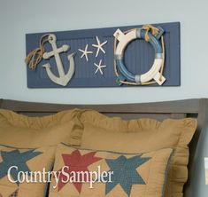 Create a backdrop for a nautical display by painting a shutter navy blue and attaching themed items, such as starfish, rope and a decorative anchor and life ring. Country Wall Decor, Country Sampler, Shutter, Starfish, Anchor, Primitive, Bed Pillows, Nautical, Backdrops