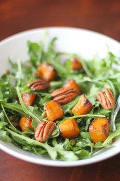 An arugula salad with roasted butternut squash and a caramelized apple vinaigrette that totally steals the show! at Bakebellissima.com