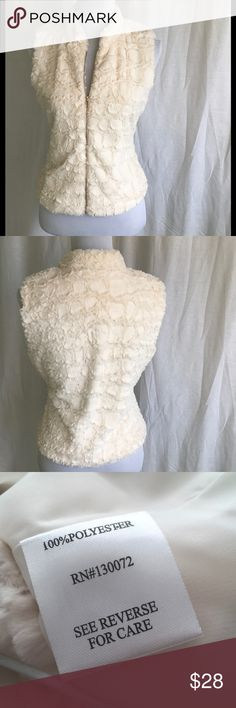 Winter White Fluffy Zippered Vest Adorable soft fluffy sleeveless winter white vest with full gold zipper. 100% poly. Dry clean only. Bust 18.5 Length 21. There is no Size label so please refer to measurements. NS. Jackets & Coats Vests