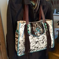 The Buckaroo Diaper Tote customized with turquoise leather lace and a turquoise suede K on the purse flap. From gowestdesigns.us