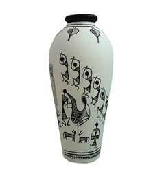 "Terracotta Handpainted ""Warli "" Vase - White:-A beautifully handcrafted terracotta vase in unique tumbler shape, hand painted in a classic combination of black and white which has Warli art painted all over it. The girls are celebrating and dancing in different poses."