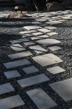 """paving with cracks between the stones"""" addresses the good feeling of walking from stone to stone. Here is a modern interpretation using precast square and rectangular stepping stones in a gravel garden. I love the rhythm it creates."""