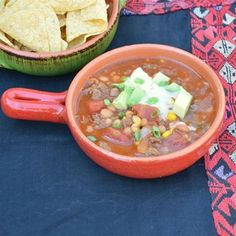 Kid-friendly and easy to throw in the slow cooker on a busy day! Top with tortilla chips, cheese, and sour cream.  Allrecipes.com