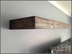 add 3 pieces of wood to floating Ikea shelf for pottery barn look (on the cheap)