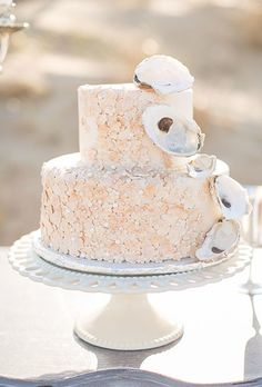Delicate shells are the perfect beach-inspired accent for your wedding cake, as seen on this option from Buttercream Dreams.