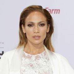 Jennifer Lopez shimmery, sexy eye makeup, glossy nude lips, and sleek straight hair at the Billboard Latin Music Awards