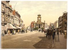 This Victorian photochrom image shows The Town Hall from South Street, Worthing. In 1818 Michael Morrah, one Worthing's doctors, proposed that a clock-tower should be erected in the town, using funds to be raised by public subscription. Victorian London, Victorian Era, Kingdom Of Great Britain, Old London, British History, Worthing, Stock Pictures, Old Photos, England