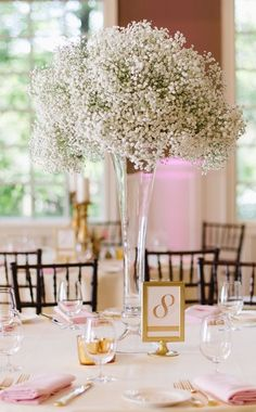 Photographer: Natalie Franke Photography; Classic green and white glass vase wedding reception centerpiece;