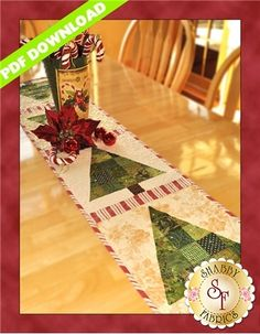 "Patchwork Christmas Tree - PDF DOWNLOAD: THIS PRODUCT IS A PDF DOWNLOAD that must be downloaded and printed by the customer. A paper copy of the pattern will not be sent to you. You'll be humming along with this Patchwork Christmas Tree table runner designed by Jennifer Bosworth for Shabby Fabrics. Finishing to 12 1/2"" x 53"", this table runner uses green scraps to make patchwork Christmas trees. Add a little sparkle with hot set glass jewels, and your holiday is complete!This product does…"