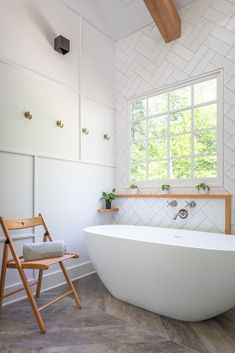 Modern Farmhouse Style Bathroom Design with Textured Walls, Herringbone Floors, Double Stacked Herringbone Tile, Natural Stained Wood Beams, Brass Robe Hooks. Bathroom Floor Tiles, Wall Tiles, White Tile Backsplash, Backsplash Ideas, Tile Ideas, Herringbone Wall, House On The Rock, Tiny House, Modern Farmhouse Bathroom