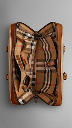 Cotton Gabardine Briefcase   Burberry $1,050.00 Item 38794241 DARK OCHRE         Sartorial briefcase in protective cotton gabardine with smooth leather trim         Ziparound closure, rolled leather handles and detachable shoulder strap         Check cotton interior with pocket document compartment         Smooth leather luggage tag         39 x 30 x 8cm         15.4 x 11.8 x 3.1in         100% cotton with calf leather trim         Imported