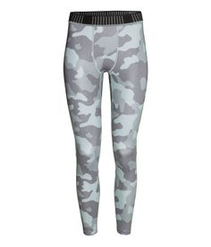 Sports tights in patterned, fast-drying functional fabric with an elasticized waistband. | H&M Sport