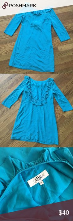 """Tibi Ruffle low-back dress This adorable piece is 100% silk in a beautiful aqua blue with minor signs of wear (pic 4). Measures 31"""" from shoulder to hem. Fully lined. Side zip. Tibi Dresses Mini"""
