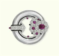 AN ART DECO ROCK CRYSTAL, DIAMOND, RUBY AND ENAMEL BROOCH