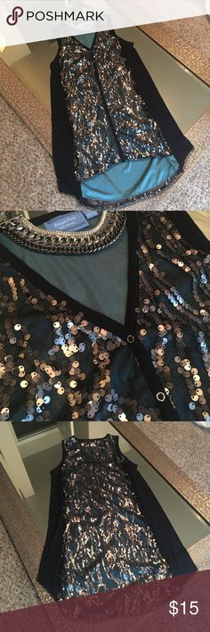 🎀SUMMER SALE, 2 for 10🎀Sequined Simply Vera top 🎀SUMMER SALE, 2 for 10🎀Hi-lo Simply Vera Vera Wang small sleeveless top. Front and back have grey-black sequins on black sheer fabric over teal lining. The sides are a very fined ribbed black fabric. GUC, from what I can tell there are no missing sequins. Very pretty and unique! Simply Vera Vera Wang Tops Blouses