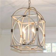 "Circle Lattice Hanging Lantern A wood look finish, geometric shapes, and simplified design make this hanging metal lantern a stylish choice. This 4 light lantern comes in Light Oak or dark Bronze ""wood"" finish with aged gold banding. Entry Lighting, Strip Lighting, Office Lighting, Light Oak, Light Bulb, Wood Circles, Kitchen Lighting Fixtures, Kitchen Island Lighting, Kitchen Islands"
