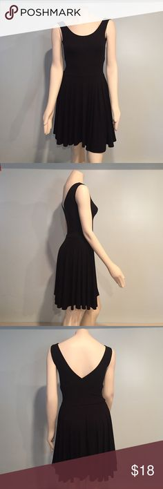 Cross back black dress Excellent used condition. No stains or snags! Pet free/smoke free home!! 🎉 make me an offer🎉 Cynthia Rowley Dresses Mini