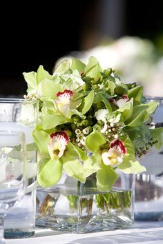 "Cymbidium orchids. This would ""pop"" against navy or dark blue bridesmaid's dresses!"