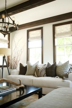 Cozy and neutral living room with white walls, exposed wood beams, and wood trim. Would be a great lower level. Cozy and neutral living room with white walls, exposed wood… Living Room White, White Rooms, Home Living Room, White Walls, Living Room Decor, Cozy Living, Living Area, Natural Wood Trim, Dark Wood Trim