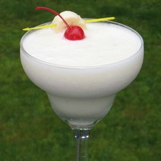 Velvet Hammer     (1.5 oz. Creme de Banana  1.5 oz. Creme de Cacao (clear)  1 oz. Vanilla Vodka  1 oz. Half & Half  Half of a Banana  1 tbsp. Simple Syrup  1 Slice of Banana and/or Chocolate shavings for garnish  1 Cherry)