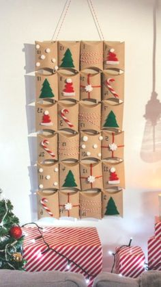 Recipe with video instructions Count down to the Big Day with this homemade advent calendar Ingredients cereal box 24 pillow boxes velcro red white and red white pipe cl. Make An Advent Calendar, Homemade Advent Calendars, Christmas Calendar, Diy Calendar, Homemade Calendar, Calendar Design, Calendar Ideas For Kids To Make, Christmas Countdown, Christmas Crafts For Kids